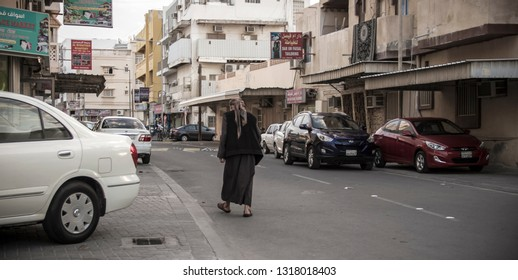 old man walking in street picture taken in manama city kingdom of bahrain at 16 feb 2019.