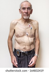 Old man wearing heart monitor