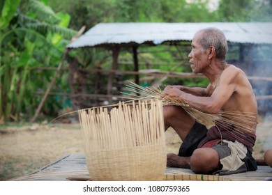 Old man are weaving bamboo baskets in the countryside.