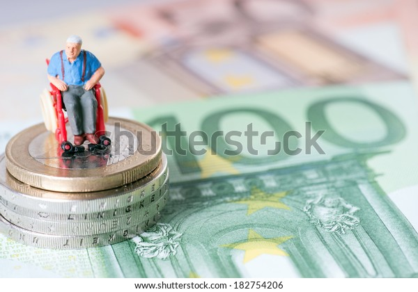 Old man in a wheelchair with money / wheelchair user