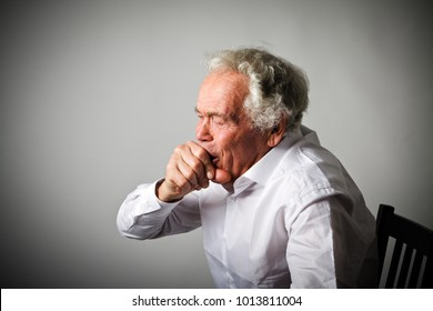 Old man in white is coughing. Symptoms and disease.