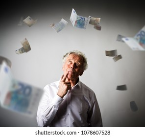 Old man in white and falling Euro banknotes. Currency and lottery concept.