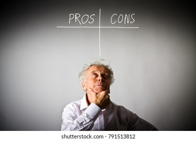 Old man in white is full of doubts and hesitation. Pros and cons concept.