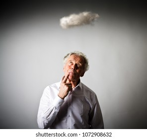 Old man in white and small cloud. Imagination and virtual cloud concept.