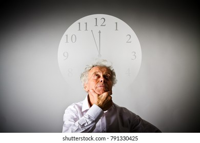 Old man in white is waiting. Time is passing.