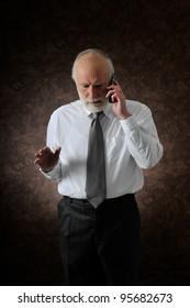 an old man who talking in phone in studio