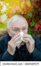 old man wipes his tears with a handkerchief. Upset distressed sick old gray-haired man close-up - Shutterstock ID 1832569579