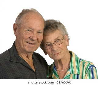 Old man and woman close together. Shot against a white background.