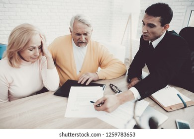 Old Man and Woman Visiting Young Lawyer in Office. Important Documents. Modern Law Office. Grandfather and Grandmother. People with Gray Hair. Young Advocate. Justice and Law Concepts.
