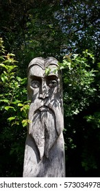 Old man wooden sculpture  in the woods