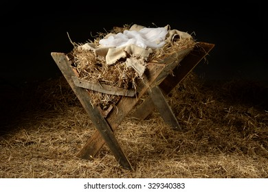 Old manger with old clothes as a symbol of waiting for Christmas