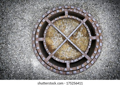 old manhole at a street