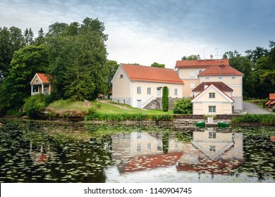 An old manor house Vihula in Estonia, Lahemaa park. Beautiful summer landscape with pond
