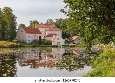 An old manor Vihula in Estonia, Lahemaa park. Beautiful summer landscape with pond