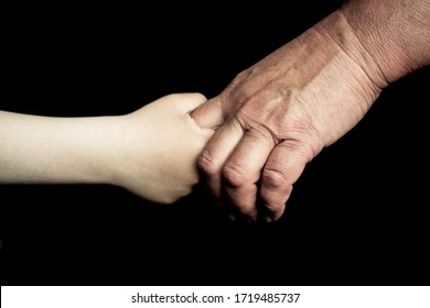 old man's and child hand