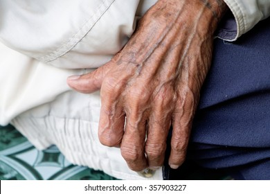 The old man's hand resting