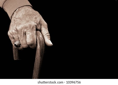 old man's hand with a walking cane