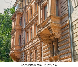 Old mansion face with stucco molding balcony. Moscow, Russia.