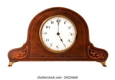 an old mantle clock isolated on white