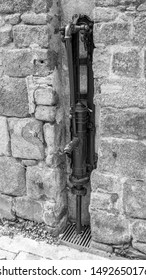 Old manual french water pump body in Black and white, Avranche Village, France