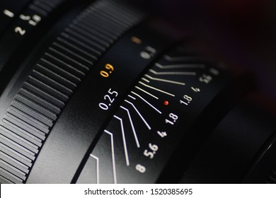 old manual photographic lens with the evident scale of the distance and the aperture