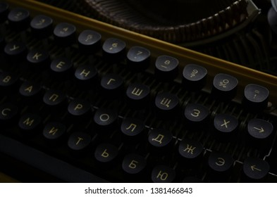 An Old manual typewriter with its working keyes with numbers and letters close up