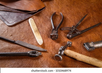 Old manufacturer's tool for leathers goods on leather skin