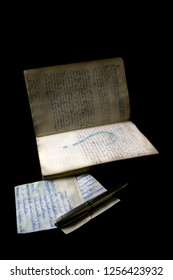 old manuscript with handwritten letters on black background