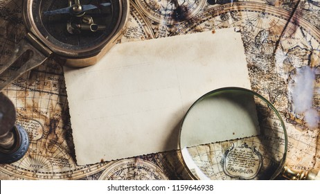 Old maps with marine equipment like compass, magnifier or hourglass and blank vintage card for your inscript. Columbus Day concept.