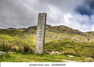 Old marker stone of the former location of the border between Cumbria and Lancashire in the English Lake District national park
