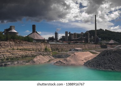 Old marl quarry with the former first Dutch cement factory in Maastricht which is converted into a public park with natural pools, with a dramatic sky