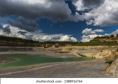 Old marl quarry in Maastricht which is converted into a public park with natural pools, with a dramatic sky. In this quarry the famous Mosasaurus was found which was stolen by the french during a war
