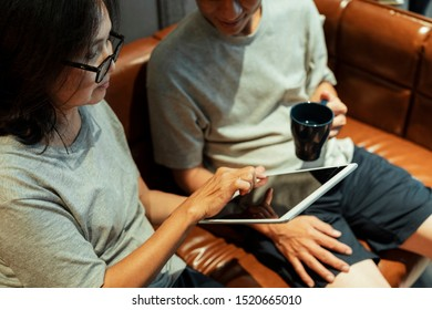 Old married couple searcing for an information of life and health insurance.