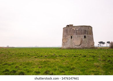 An old martello tower which acted as a sea defense fort. It has been weather worn and looks like it has a smiling face. Found in Shingle Street, Suffolk