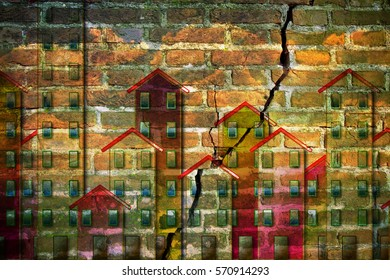 Old masonry buildings which need of a seismic improvement - concept image with buildings against a cracked brick wall