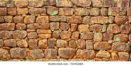 Old masonry, fence. Masonry texture of natural gray stone