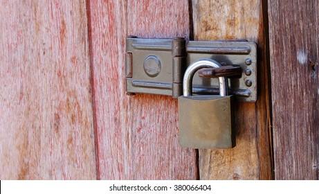 Old master key with wooden door