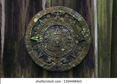 Old  Mayan Calendar on old  wooden background