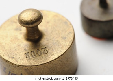 Old measure weights closeup at white background