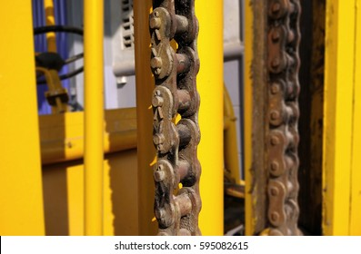 old mechanical chain on a forklift truck - Close up forklift chain.