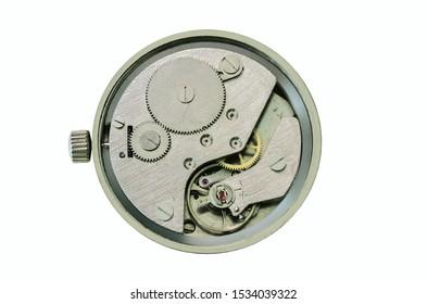 Old mechanical clockwork close-up. Clockwork with spring drive and vintage gear mechanics.