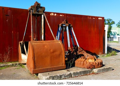 Old mechanical grab tongs and crane blades on a port facility in the harbor area of the midland channel in Hanover, Lower Saxony, Germany