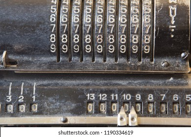 Old mechanical manual counting machine for mathematical calculations. Detail of old adding machine.