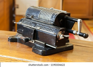 Old mechanical manual counting machine for mathematical calculations. Old soviet calculating machine