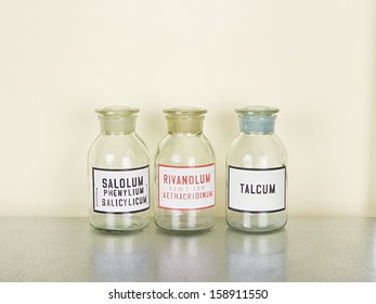 old medical glass bottles on the metal shelf