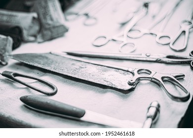 Old Medical And Surgical Instruments. Many Old Surgical Instruments For Surgery. Black And White Toned Shot. Old Different Metal Medical Instruments Objects. Retro Stainless Surgical Equipment Tools