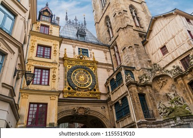 An old medieval astronomical clock in a public square in Rouen France.  The mechanism is one of the oldest in France, the movement was made in 1389.