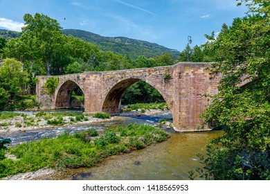 Old medieval bridge over the river Aude, in the center of Alet les Bains, Aude, South, France