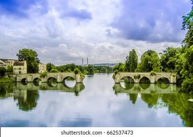 The old medieval broken arch bridge over the Seine river in Mantes-la-Jolie