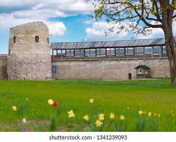 Old medieval castle of Izborsk in Russia. Tower and castle wall with blue cluody sky in background.